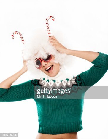 portrait of young woman holding candy canes : Stock Photo