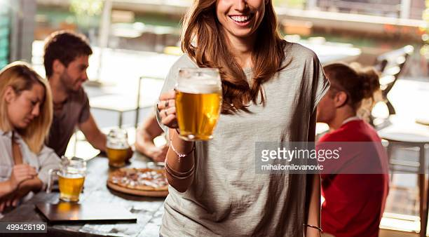Portrait of young woman in a bar