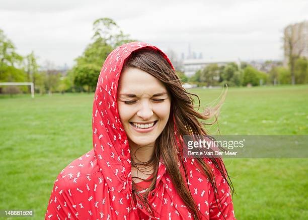 Portrait of young woman in bad weather.