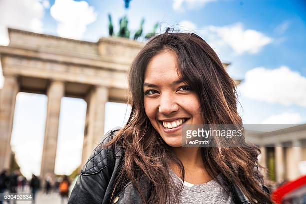 Portrait of young woman in Berlin - Brandenburg Gate