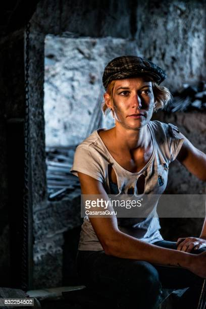 Portrait of Young Woman in Blacksmith Shop