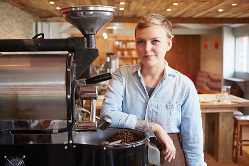 Portrait of young woman in coffee roastery