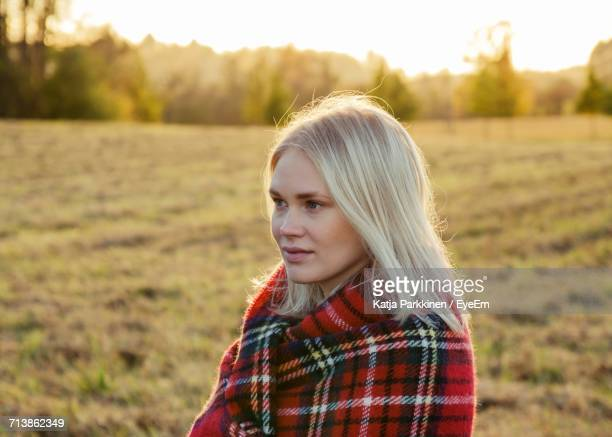 Portrait Of Young Woman In Field