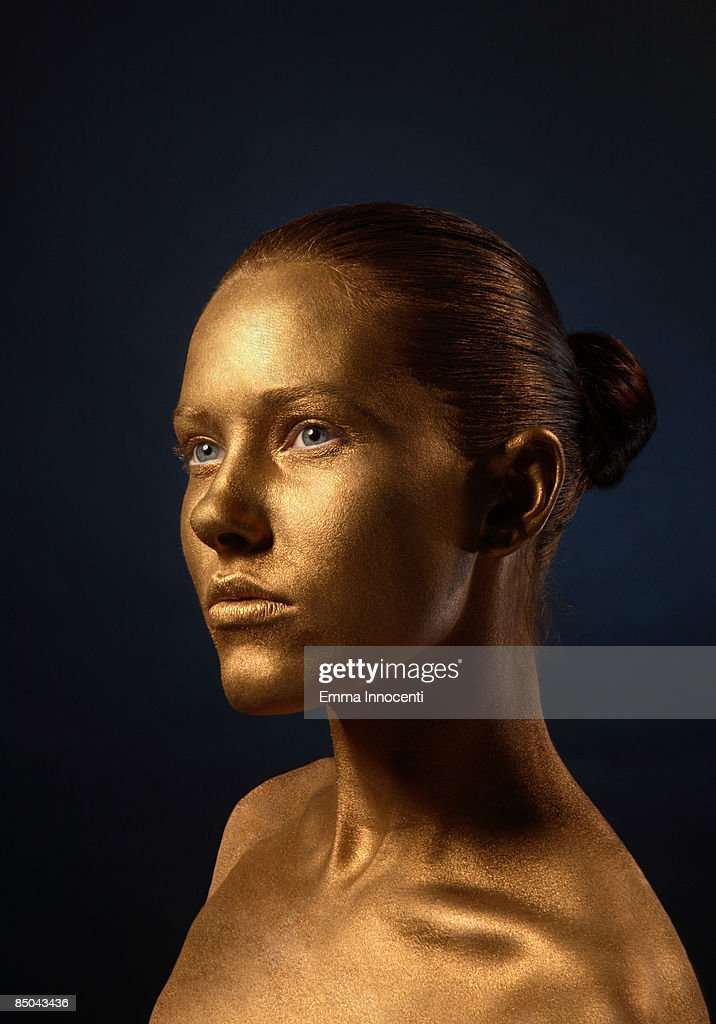Portrait of young woman in Gold : Stock Photo