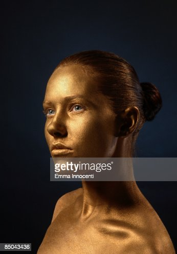 Portrait of young woman in Gold : ストックフォト