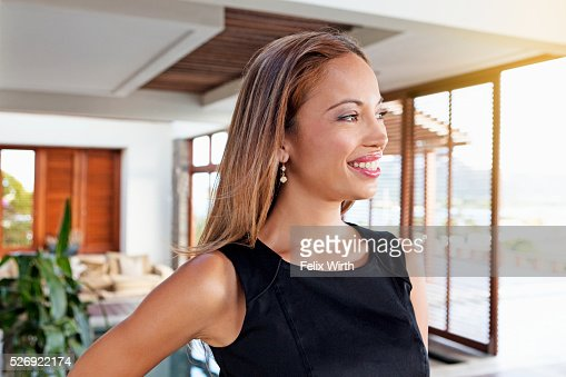 Portrait of young woman in modern home : Stock-Foto