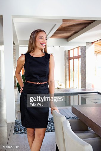 Portrait of young woman in modern home : Stock Photo