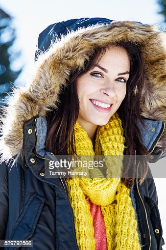 Portrait of young woman in overcoat with hood : Stock Photo