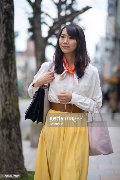 Portrait of young woman in shopping