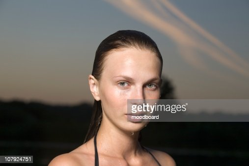 Portrait of young woman in swimming costume at dusk : Stock Photo