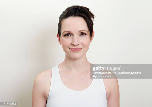 Portrait of young woman in white vest