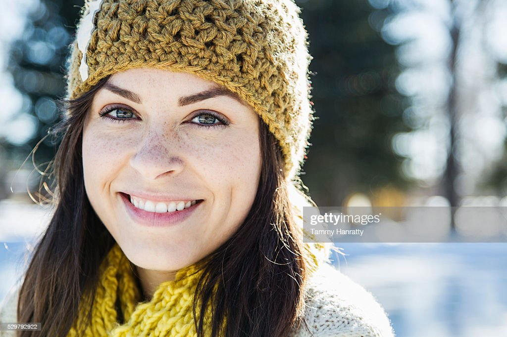 Portrait of young woman in woolen hat : Foto de stock