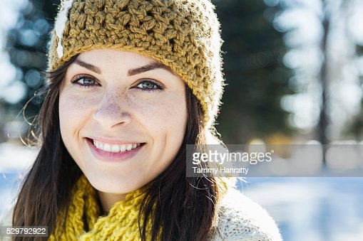 Portrait of young woman in woolen hat : Bildbanksbilder