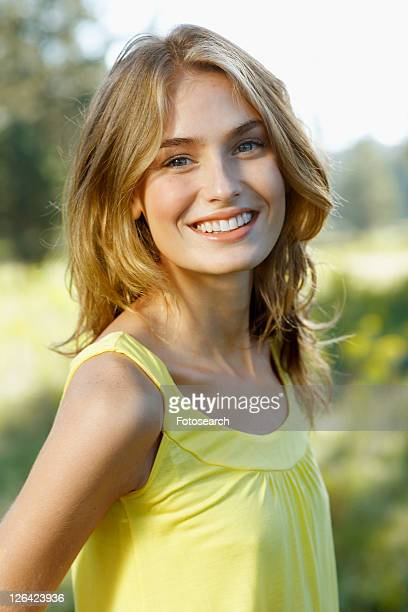 Portrait of young woman in yellow tank top