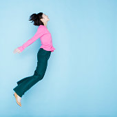 Portrait Of Young Woman Jumping