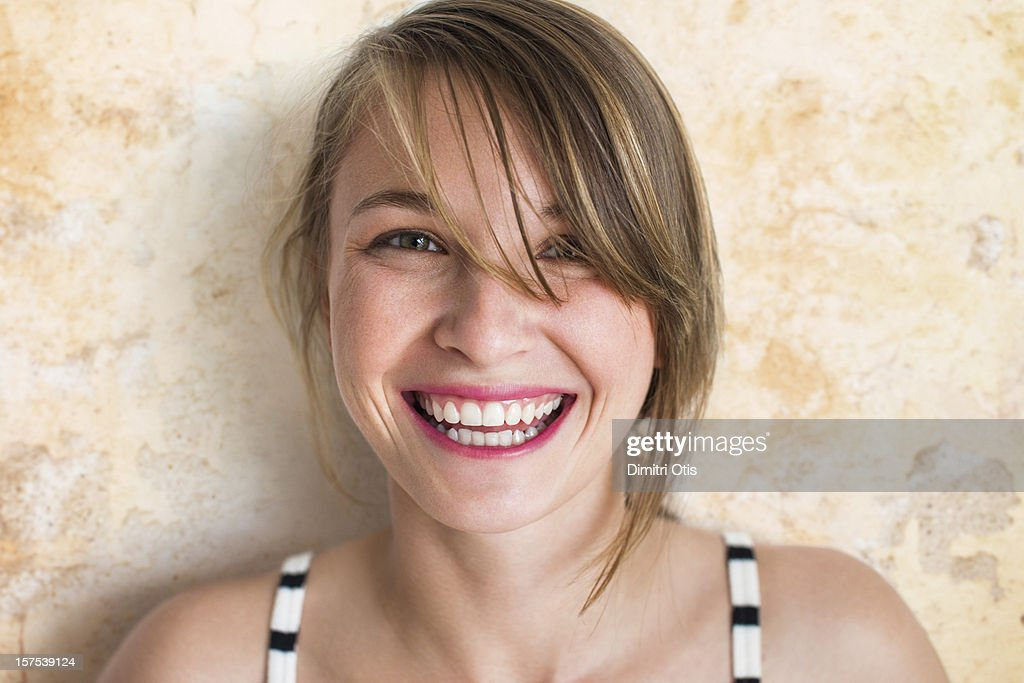 Portrait of young woman, laughing : Stock Photo