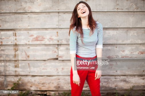 Portrait of young woman laughing : Stock Photo