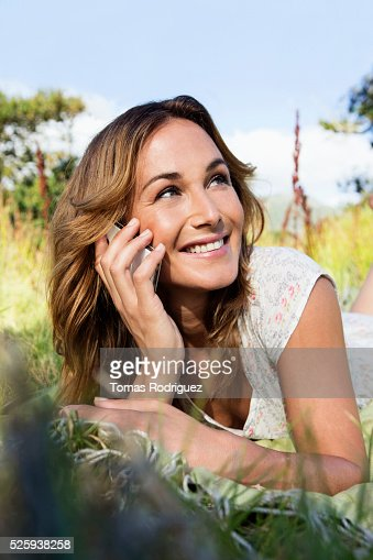 Portrait of young woman laying on blanket : Stock Photo