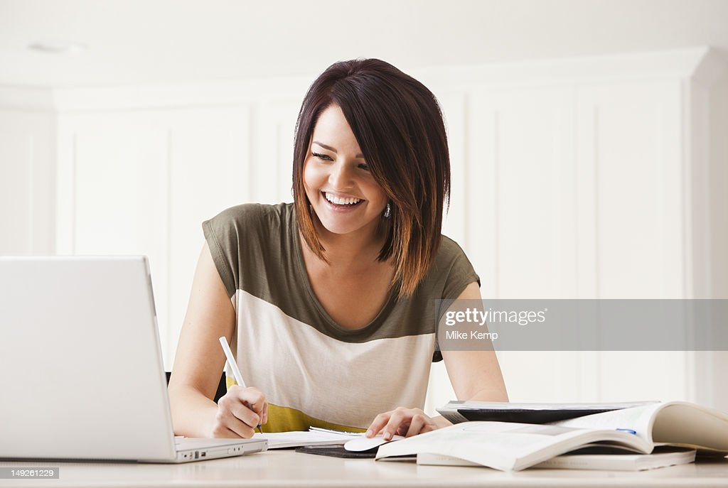 Portrait of young woman learning at home