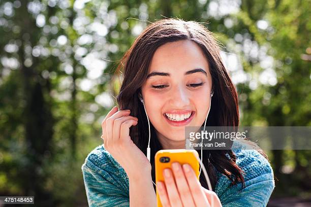 Portrait of young woman listening to music