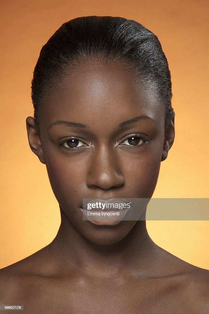Portrait of young woman looking at camera : Stock Photo