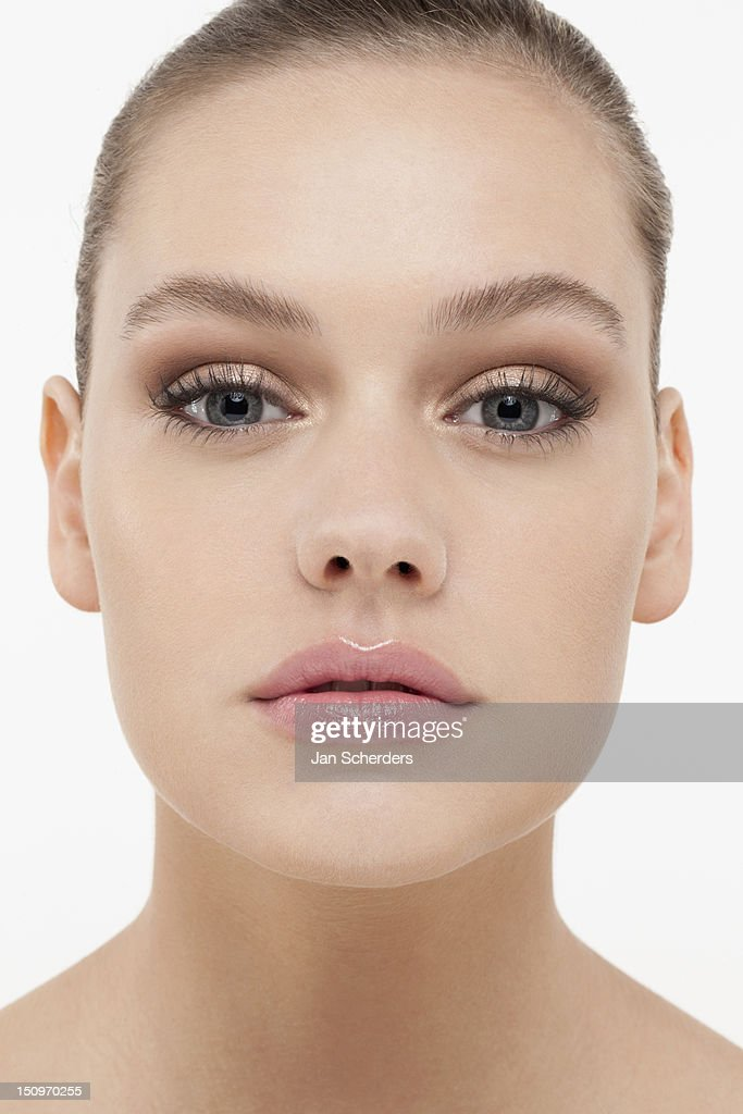 Portrait of young woman looking straight at camera : Stock Photo
