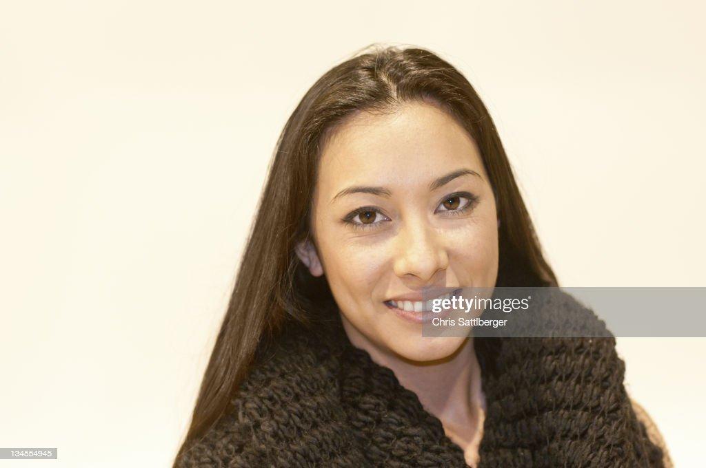 Portrait of young woman of Hispanic-Asian origin : Stock Photo