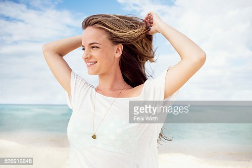 Portrait of young woman on beach : Bildbanksbilder