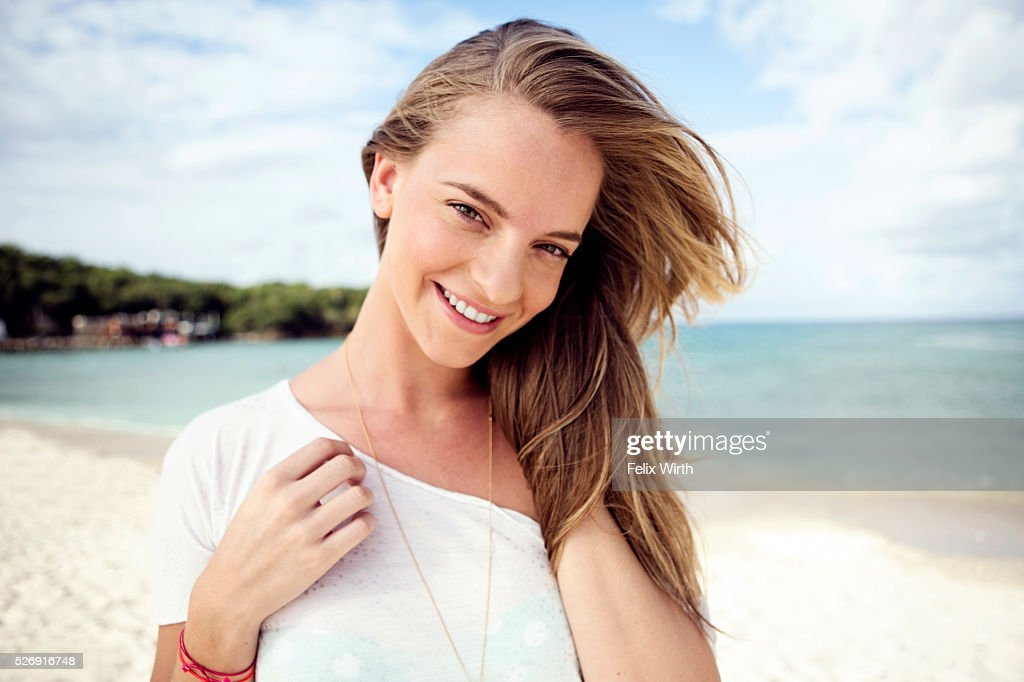 Portrait of young woman on beach : Stock Photo