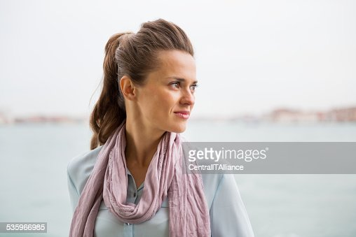 portrait of young woman on embankment : Stock Photo