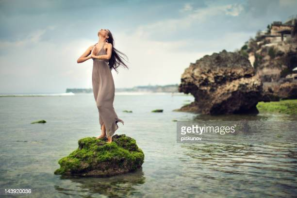 Portrait of Young Woman on Rocks