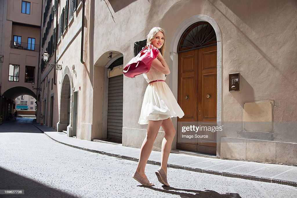 Portrait of young woman on street : Stock Photo