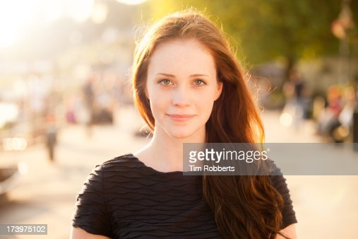 Portrait of young woman on sunny summer evening.