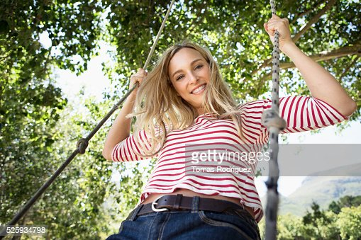 Portrait of young woman on swing : Photo