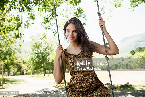 Portrait of young woman on swing : Foto de stock