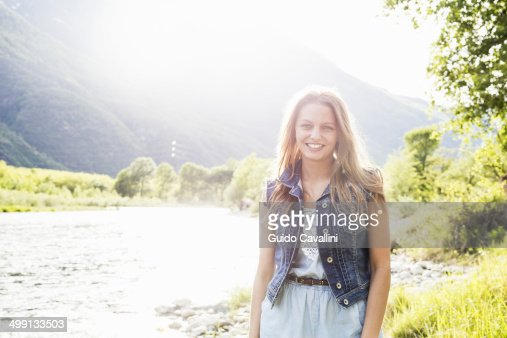 Portrait of young woman on Toce riverbank, Piemonte, Italy
