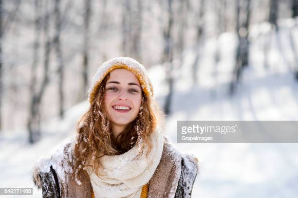 Portrait of young woman outside in winter.