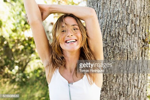 Portrait of young woman posing in park : Stock-Foto