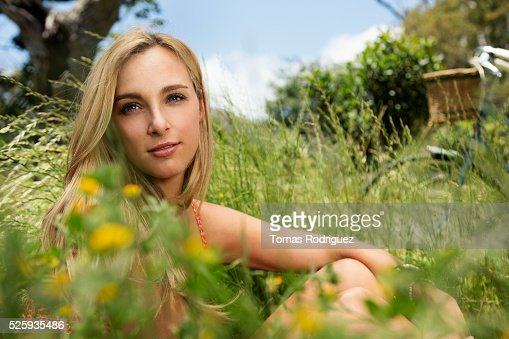 Portrait of young woman relaxing at summer : Stock Photo