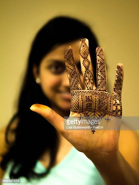 Portrait Of Young Woman Showing Henna Tattoo