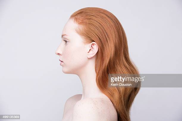 Portrait of young woman, side view, bare shoulders