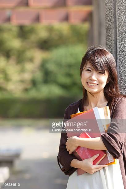 Portrait of young woman smiling, Japan