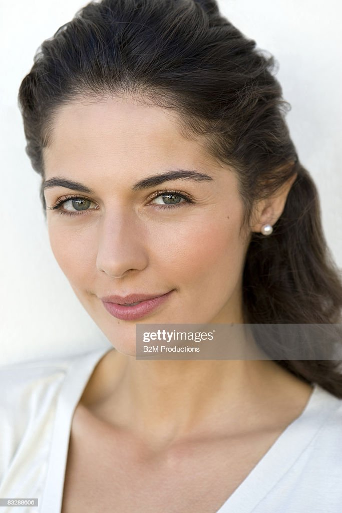 Portrait of young woman, smiling : Stock Photo