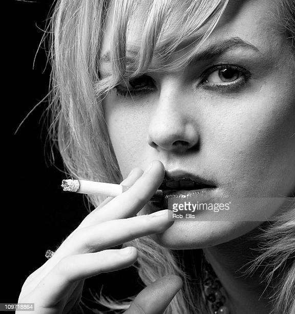 Portrait of Young Woman Smoking Cigarette, Black and White