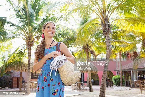 Portrait of young woman standing on beach : Stock Photo