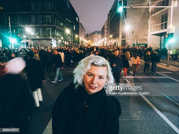 Portrait Of Young Woman Standing On Crowded Street During Celebrations Of The Fall Of The Berlin Wall