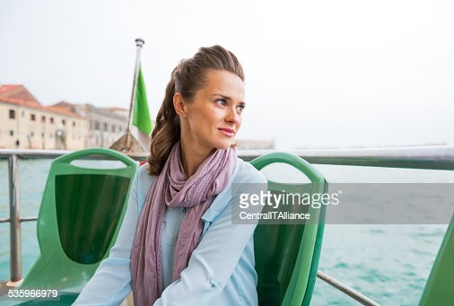 Portrait of young woman travel by venice water bus : Stock Photo
