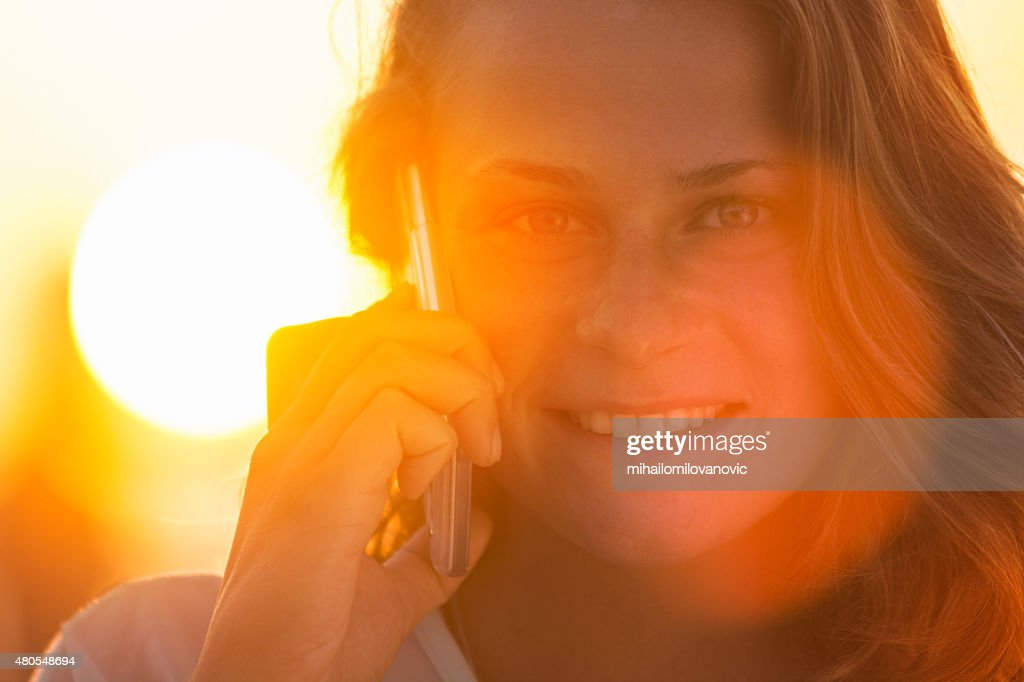 Portrait of young woman using mobile phone : Stock Photo