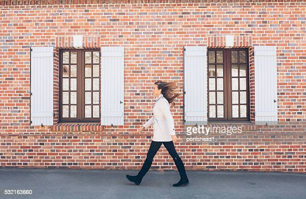 Portrait of young woman walking on street