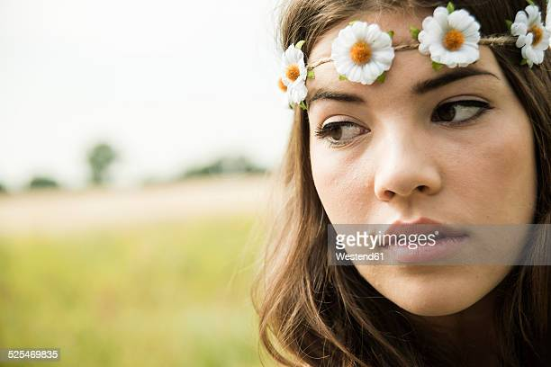 Portrait of young woman wearing floral wreath
